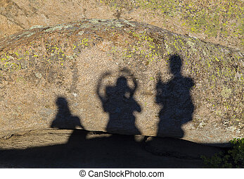 Shadows of happy people