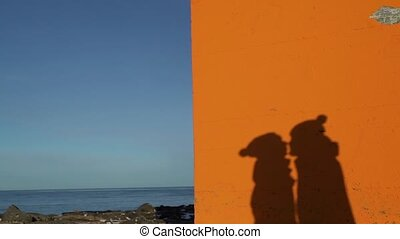 Shadows of kissing couple on the wall