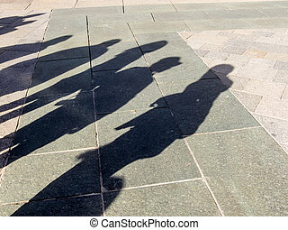shadows of people, symbolic photo for anonymity, city life,...