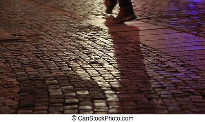 Shadows of people walking in a cobblestone street - People...
