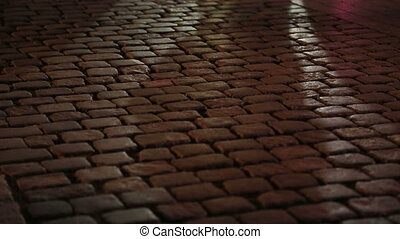 Shadows of people walking in a cobblestone street - People...