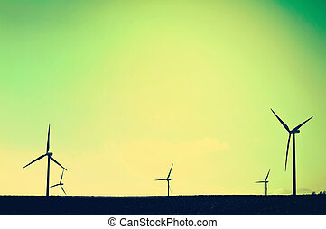 Shadows of windmills on the field. Vintage instagram picture. Alternative energy.
