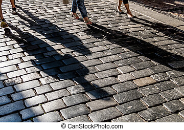 shadows on pavement - shadows of people on a pavement