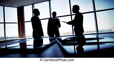 Shady business - Shady image of a manager discussing...