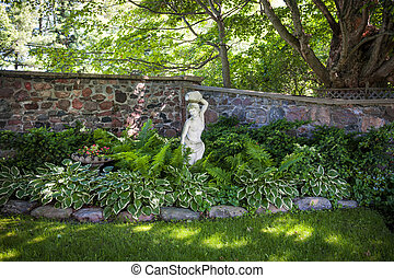 Shady perennial garden - Lush green summer garden with...
