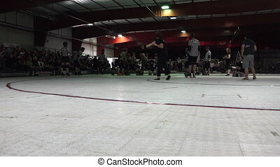 Shady Start of A Roller Derby Cont - Out of the dark comes...