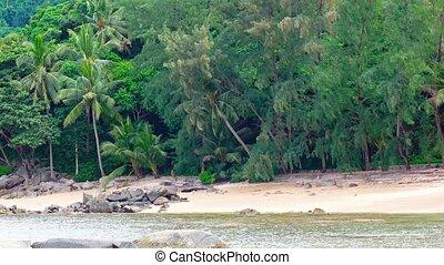 Shady Treeline over a Tropical Beach Paradise in Thailand -...