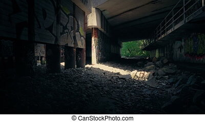 Shaft Of Light In Grungy Area Under Bridge - Sunlight shines...