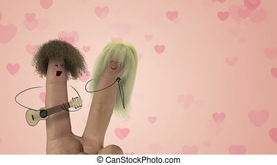 Shaggy hair finger guitar man sing fun romantic love song to blonde finger women. Valentines day joke.