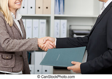 shake hands after an interview