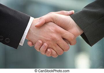 shake-hands - two businessman shake hands