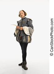 William Shakespeare in period clothing holding feather pen looking at viewer.