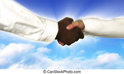 Shaking hands against a sky background