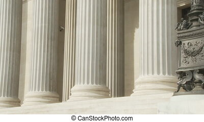 shaking hands between pillars - two businessman coming out...