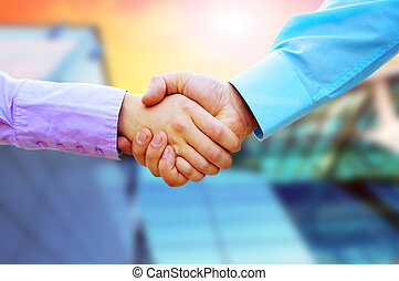 Shaking hands of two business people - Shaking hands of two...