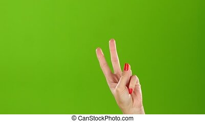 Shaking woman hand gesture denoting the peace. Green screen...