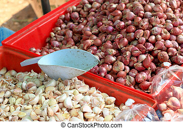 Shallots and garlic - asia red onion in market.