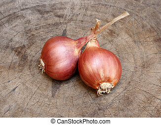 shallots on old wooden
