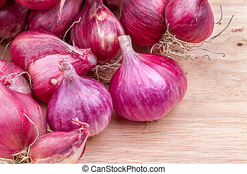 shallots on wooden background