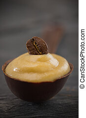 shallow coffee mousse in a chocolate spoon