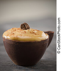 shallow coffee mousse in a dark chocolate cup