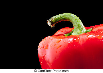 Shallow focus horizontal close up of a red pepper on black
