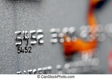 Shallow focus horizontal macro of a silver credit card