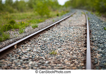 Shallow focus of train tracks in nature on an overcast day