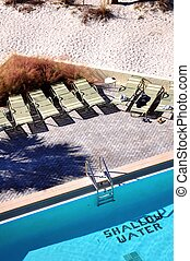 Shallow Water Hotel Pool. Top View. Florida, USA. Vertical Photo