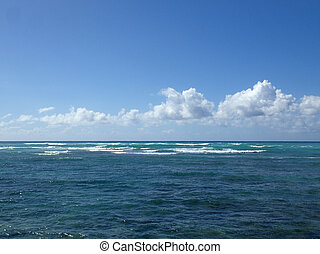 Shallow wavy ocean waters of Waimanalo bay looking into the paci