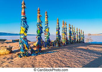 Shaman totem poles at Cape Burkhan on Olkhon Island in Lake...