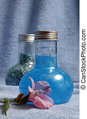 Shampoo and salt for baths - Blue towels and two bottles...