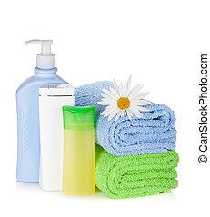 shampoo, flor, garrafas, toalhas, gel