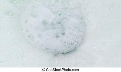 Shampoo Washing Away In Shower - Closeup of shampoo washing...