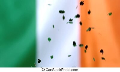 Shamrock confetti falling on irish flag in slow motion
