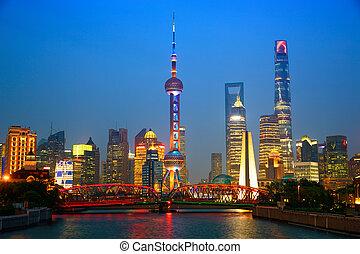 Shanghai at dusk - Shanghai skyline at dusk with illuminated...