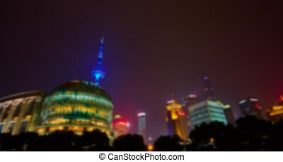 Shanghai at night - Shanghai skyline at night out of focus....