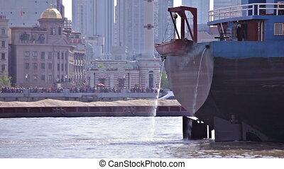 Shanghai, China, 2013 April-May Waitan embankment of Shanghai, The barge floats along the river.