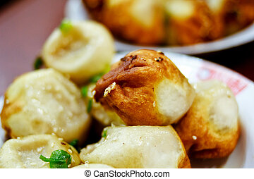 Shanghai fried dumpling - Known as sheng jian bao to the...