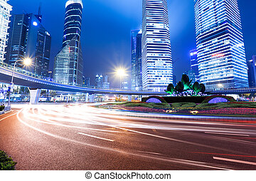 shanghai lujiazui downtown at night - light trails on...