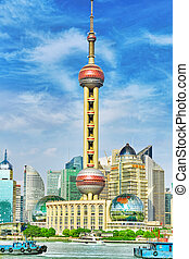 SHANGHAI-MAY 24, 2015. Oriental Pearl Tower on  blue sky background. Tower  470 meter the Oriental Pearl is one of Shanghai's tallest buildings, located at Lujiazui finance and trade zone in Pudong district in most dynamic city of China.