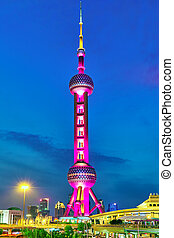 SHANGHAI-MAY 24, 2015. Oriental Pearl Tower at the nighttime. Tower  470 meter the Oriental Pearl is one of Shanghai's tallest buildings, located at Lujiazui finance and trade zone in Pudong district in most dynamic city of China.