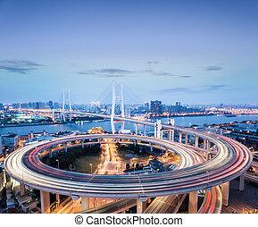 shanghai nanpu bridge in nightfall, busy traffic background