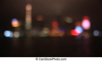 China, Shanghai, Pudong, Huangpu River, skyline at night, coming into focus