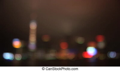 China, Shanghai, Pudong, River Huangpu, skyline at night, coming into focus