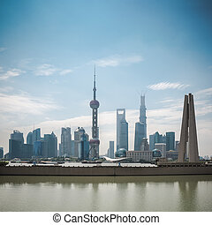 shanghai pudong skyline in daytime with monument and suzhou ...