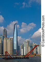 shanghai pudong view from puxi ,with big red crane boat...