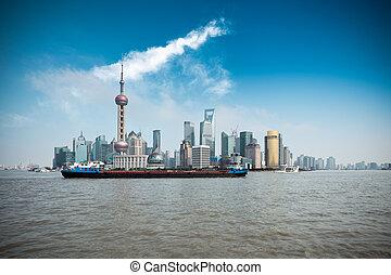 shanghai skyline and a cargo ship