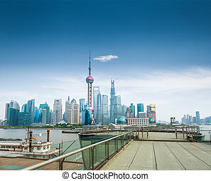 shanghai skyline and a sightseeing platform with blue sky...