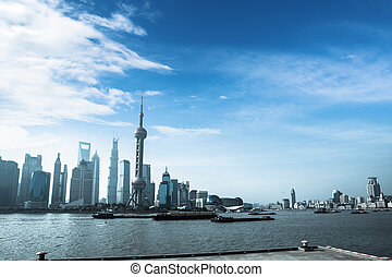shanghai skyline and busy huangpu river - shanghai against a...